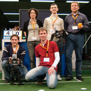 Team NimbRo at the Dutch Open 2006: Front row from left: Jörg Stückler, Michael Schreiber. Back row from left: Maren Bennewitz, Reimund Renner, Sven Behnke.